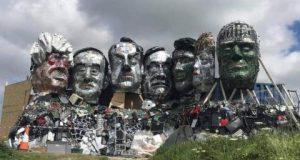 لإيقاظ ضمائرهم... تمثال لرؤوس قادة الدول السبع من النفايات الإلكترونية (صور)
